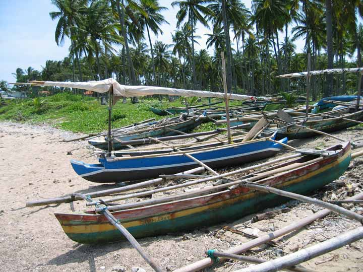Canoes on the beach in Anjer, Java
